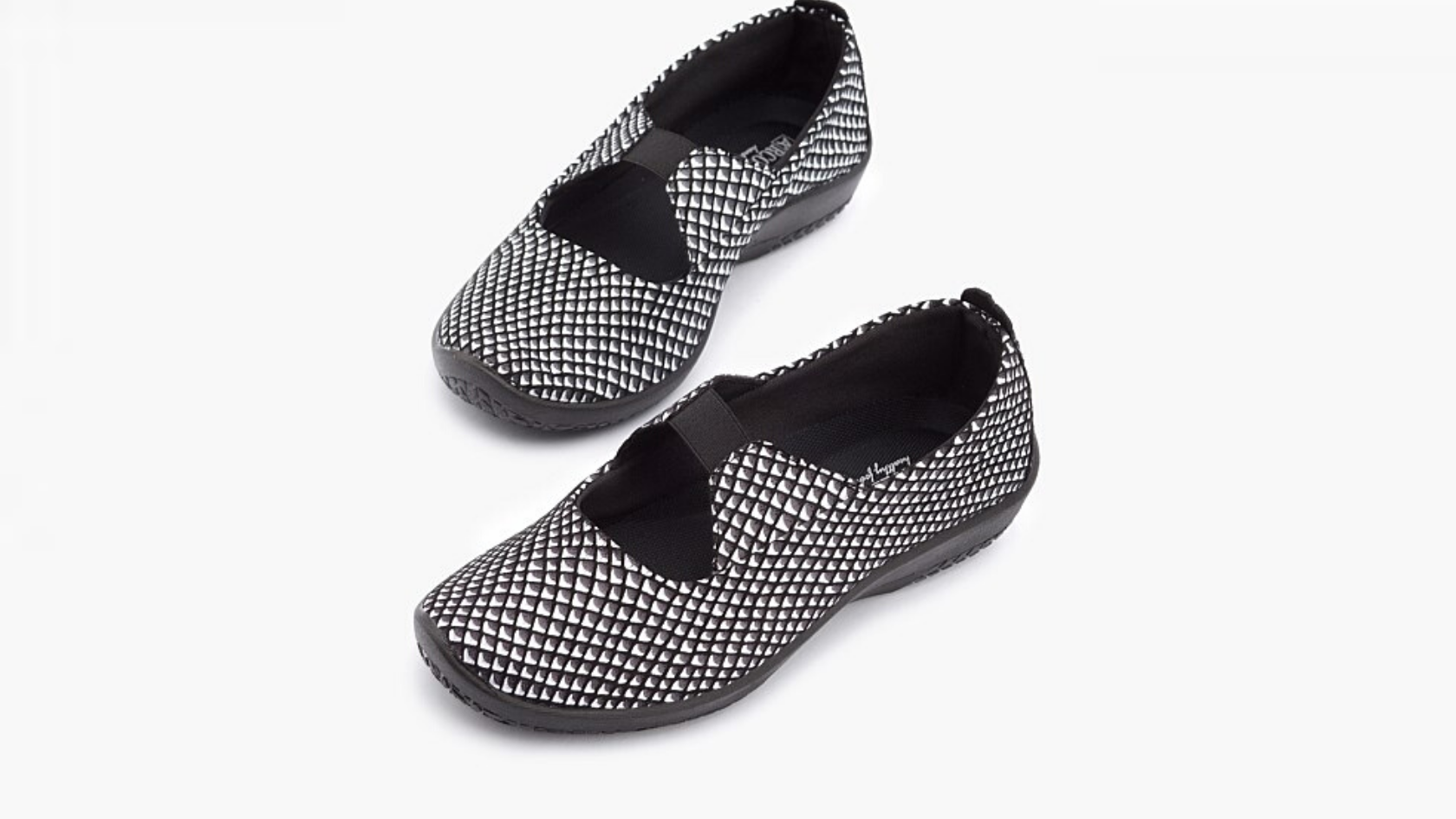 Pair of white/black geometric Leina's against a white background
